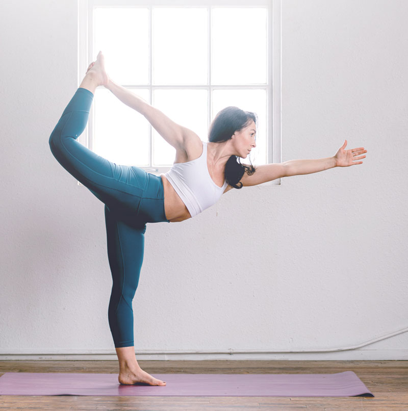 Young woman - yoga warrior pose