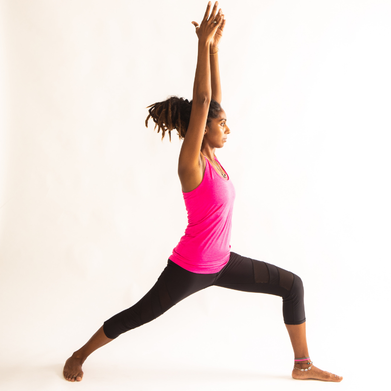 Young woman - yoga warrior pose